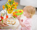 Baby eating Easter cookies Stock Photography