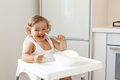 Baby eating fruit Royalty Free Stock Photo
