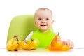 Baby eating fruits Royalty Free Stock Photo