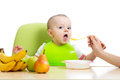 Baby eating healthy food fruits
