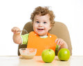 Baby eating by himself boy Royalty Free Stock Photography