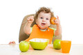 Baby eating by himself boy Royalty Free Stock Images