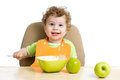Baby eating by himself boy Royalty Free Stock Photos