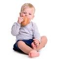 Baby eats bread Royalty Free Stock Photo