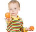 Baby eats fruit on a white background Royalty Free Stock Photography