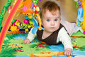 Baby in educational mat Royalty Free Stock Images