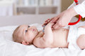 Baby examined by doctor Royalty Free Stock Photo