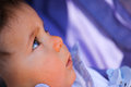 Baby eyes looking up with intertest Stock Photo