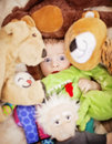 Baby face in toys a pile of stuffed Royalty Free Stock Photography