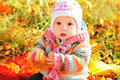 Baby in fall time sitting with leaf Stock Photography