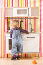 Baby family girl daughter play cooking in toy kitchen Royalty Free Stock Photo