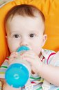 Baby with feeding bottle age of months Stock Photography
