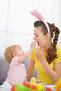 Baby feeding mother Easter biscuits Royalty Free Stock Photography