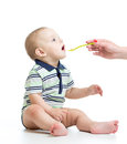 Baby feeding with a spoon little Royalty Free Stock Photography