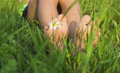 Baby feet on the grass close up lying green Royalty Free Stock Photos