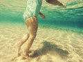 Baby feet walking underwater Royalty Free Stock Photo