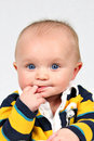 Baby with fingers in mouth Royalty Free Stock Photo