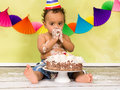 Baby first birthday adorable african during a cake smash on his Royalty Free Stock Photos