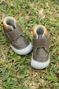 Baby first shoes on the green grass Stock Photo