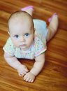 Baby on the floor laying wooden Stock Image