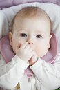 Baby folding hands at mouth closeup photo Stock Image