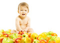 Title: Baby food. Child sitting inside fruits over white background. He