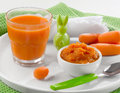 Baby food healthy pureed carrot and juice Stock Images