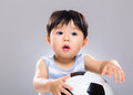 Baby football lover with gray background Stock Photo