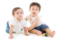 Baby friendships two lovely asian babies sitting on the floor Stock Photography