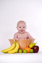 Baby in fruit bowl boy Stock Photo