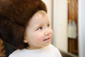 Baby in Fur Cap Royalty Free Stock Photography