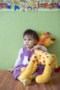 Baby with giraffe Stock Images
