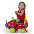 Baby girl and airplane toy happy sits on a red clapping hands Stock Images