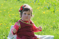 Baby girl along dandelion lawn Royalty Free Stock Photo