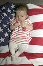 Baby  girl on  American flag Royalty Free Stock Photography
