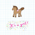 Baby girl arrival card with horse toy cartoon over a math paper background pink text and colored dots Stock Photo