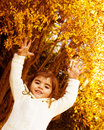 Baby girl in autumn park Stock Images