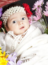 Baby Girl in Basket of FLowers Stock Photos