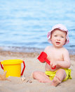 Baby girl on the beach Stock Image