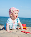 Baby girl on the beach Stock Images
