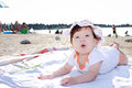 Baby girl on the beach happy enjoying morning sun at Royalty Free Stock Images