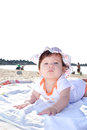 Baby girl on the beach happy enjoying morning sun at Stock Photos