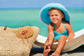 Baby girl in big hat relax at exotic beach Royalty Free Stock Photo
