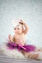 Baby girl with bunny ears and pearls Royalty Free Stock Images
