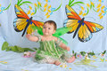Baby girl with butterfly wings Stock Photography