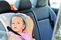 Baby girl in car sitting Stock Images