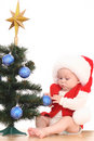 Baby girl and Christmas tree Royalty Free Stock Image