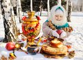 Baby girl in coat and headscarf in the Russian samovar in the ba Royalty Free Stock Photo