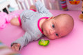 Baby girl in the cradle lying down Royalty Free Stock Photos