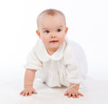 Baby girl crawling isolated on white background and looking toward Stock Photo